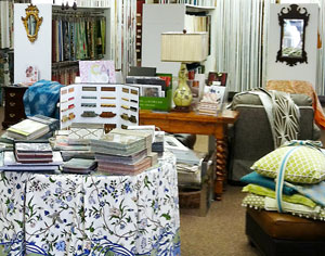 Photo of fabric samples, pillows and furniture
